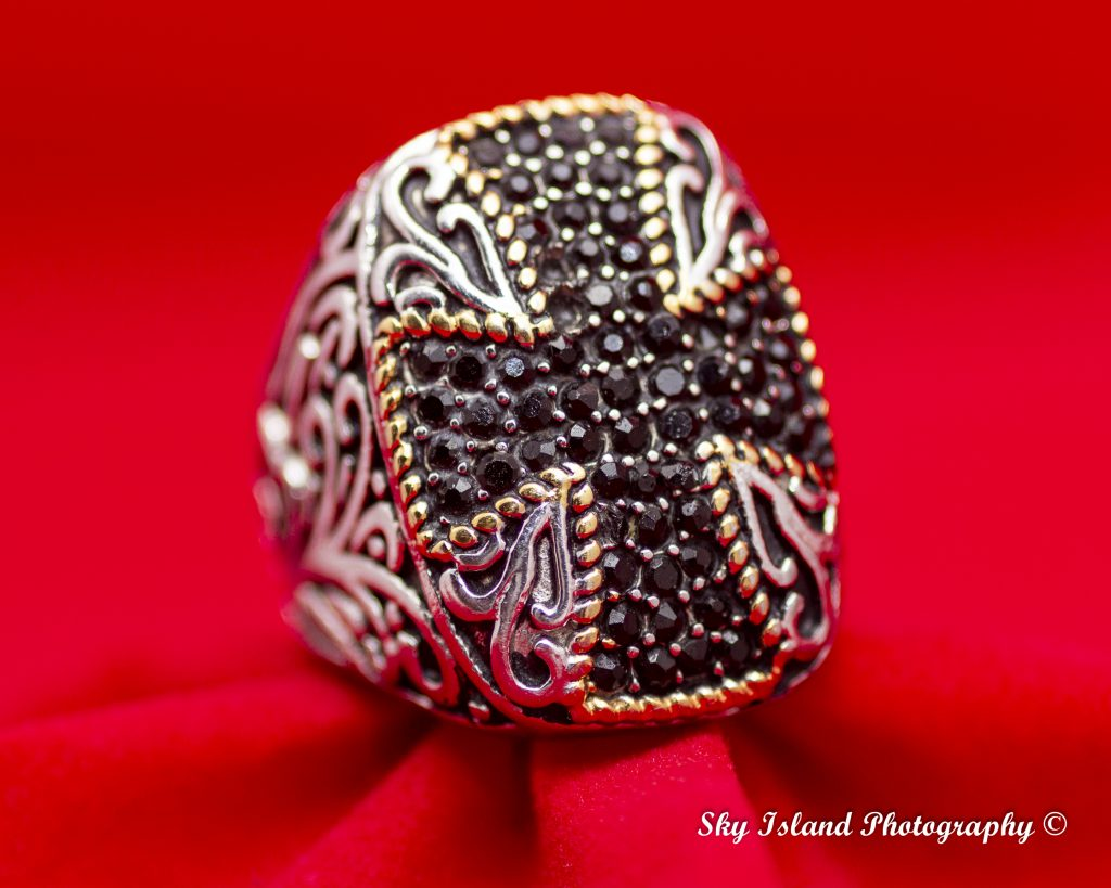 Mens sapphire ring on red setting with two stone missing. Sky Island photography John Heyward