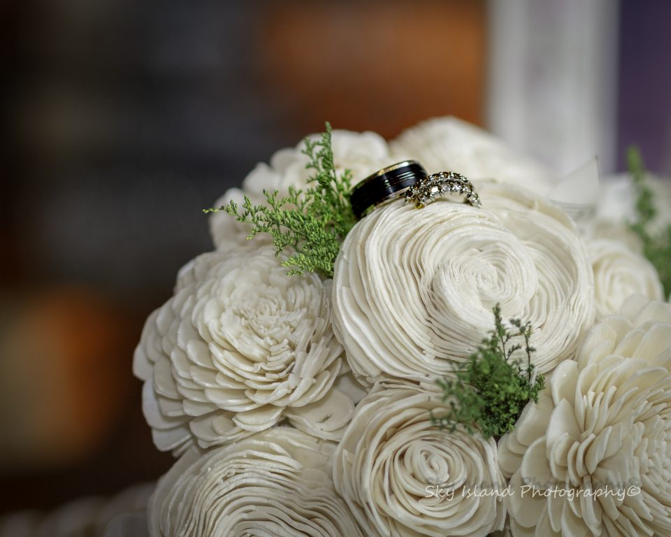 White wedding Bouquet with wedding rings Captured in Bethlehem Pa by John Heyward Sky Island Photography