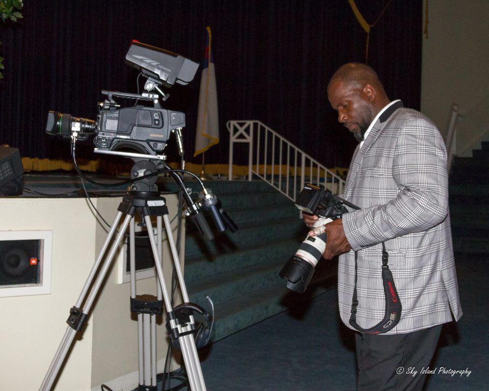 Sky Island Photography John Heyward professional photographer reviewing image while photographing an event. Baltimore Maryland